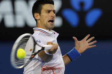 Djokovic of Serbia hits a return to Nadal of Spain during their men's singles final match at the Australian Open tennis tournament in Melbourne