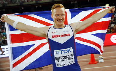 Greg Rutherford of Britain celebrates after winning gold in the men's long jump final during the 15th IAAF World Championships at the National Stadium in Beijing