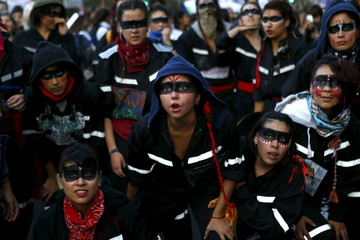 Women shout slogans during a demonstration to mark International Women's Day in Santiago