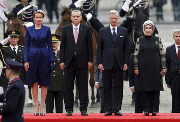 Belgium's King Philippe, Queen Mathilde, Turkey's President Erdogan and his wife Emine Erdogan listen to their national anthems during a welcome ceremony outside the Royal Palace in Brussels