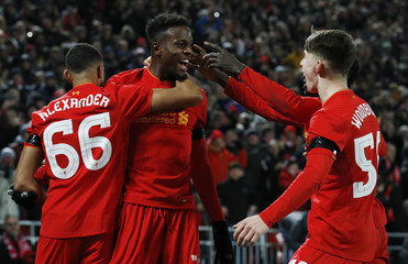 Liverpool's Divock Origi celebrates scoring their first goal with Ben Woodburn and Trent Alexander-Arnold