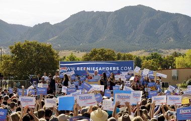 Democratic presidential candidate Bernie Sanders speaks to a crowd with Boulder's signature Flatirons mountain range in the background at the University of Colorado in Boulder