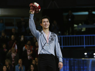 Chan of Canada waves from the podium with his gold medal after his free skate men's program during the Skate Canada International figure skating competition in Saint John
