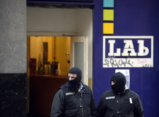 Spanish civil guards wearing uniforms of the cyber terrorism division stand guard outside the Lab Basque nationalist trade union during a police operation against suspected members of a support structure for Basque separatists ETA, in Bilbao