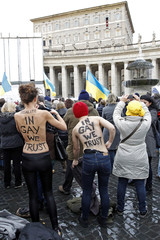 Activists from the women's rights group Femen protest as Pope Benedict XVI leads his Angelus prayer in Saint Peter's Square at the Vatican