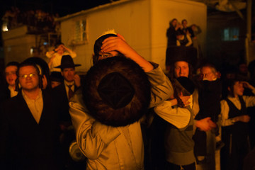 An Ultra Orthodox Jewish man watches a bonfire during the Jewish holiday of Lag Ba-Omer in Jerusalem