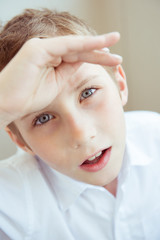 Closeup portrait of teenage boy in a white shirt
