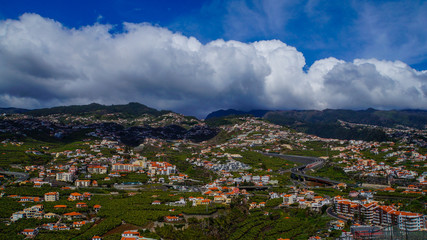 Madeira - Green island with banana plants and houses on the mountains from Miradouro de Torre
