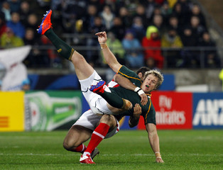Wales' Jamie Roberts tackles South Africa Springboks' Jean de Villiers during their Rugby World Cup Pool D match at Wellington Regional Stadium in Wellington