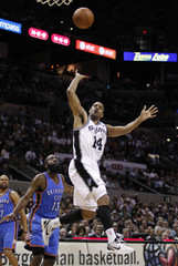 Spurs point guard Gary Neal (14) gets past Oklahoma City Thunder guard James Harden during Game 2 of the NBA Western Conference basketball finals in San Antonio
