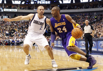 Lakers shooting guard Bryant drives on Mavericks point guard Kidd during their NBA basketball game in Dallas Texas