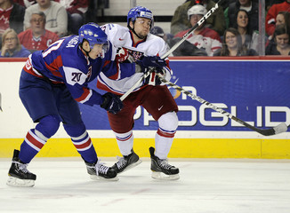 Slovakia's Meili and Czech Republic's Hrbas battle for the puck during play at the 2012 IIHF U20 World Junior Hockey Championship in Calgary.