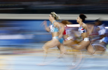 Khubbieva of Uzbekistan and Williams of Britain run in the women's third 60 meters semi-final during the world indoor athletics championships in Istanbul