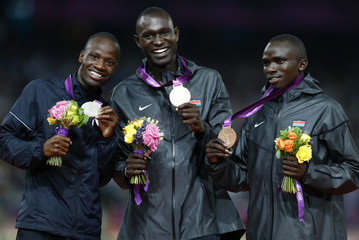 Medallists pose during the presentation ceremony for the men's 800m event at the London 2012 Olympic Games at the Olympic Stadium