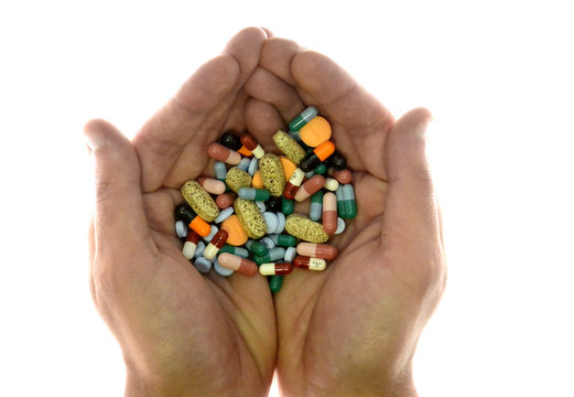 A person holds pharmaceutical tablets and capsules in illustration picture in Ljubljana