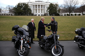 U.S. President Trump shakes hands with Levatich, CEO of Harley Davidson, accompanied by Vice President Pence, during a visit of the company's executives at the White House in Washington U.S.