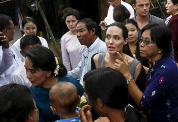 Myanmar pro-democracy leader Aung San Suu Kyi and UNHCR special envoy Angelina Jolie Pitt meet with female factory workers at their hostel in the Hlaingtaryar Industrial Zone in Yangon