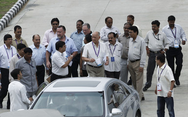 Commonwealth Games Federation President Fennell leaves the Thyagraj sports complex in New Delhi