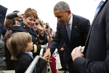 U.S. President Obama shakes hands upon his arrival at Moffatt Field in San Jose