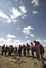 Indigenous Bolivians participate an indigenous ceremony near Sica Sica town, before marching to La Paz