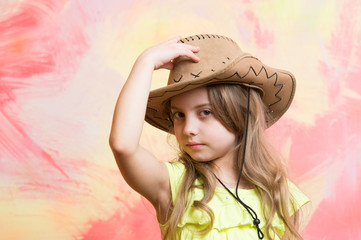 cowboy hat on adorable girl wearing american outfit