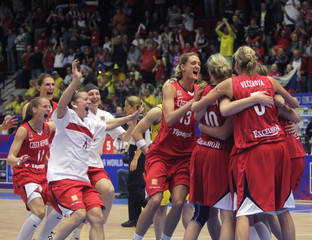 Members of Czech Republic's team celebrate victory against Australia during the FIBA World Championship women's basketball tournament in Karlovy Vary
