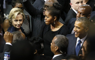 U.S. Democratic presidential candidate Clinton talks with President Obama and the first lady after funeral services for Rev. Clementa Pinckney in Charleston