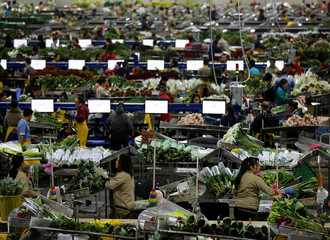 Employees organise bouquets of flowers to be exported overseas, ahead of Valentine's Day, at a farm in Facatativa