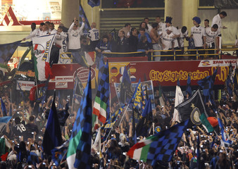 Inter Milan players and staff celebrate on a bus after the team won their 18th league title, in Duomo square, downtown Milan