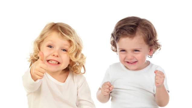 Two happy small children saying Ok and laughing