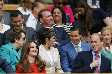 Britain's Catherine Duchess of Cambridge and Prince William (R) smile in the royal box on Centre Court at the Wimbledon Tennis Championships in London