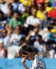 Argentina's Messi reacts after missing a goal scoring opportunity against Switzerland during their 2014 World Cup round of 16 game at the Corinthians arena in Sao Paulo