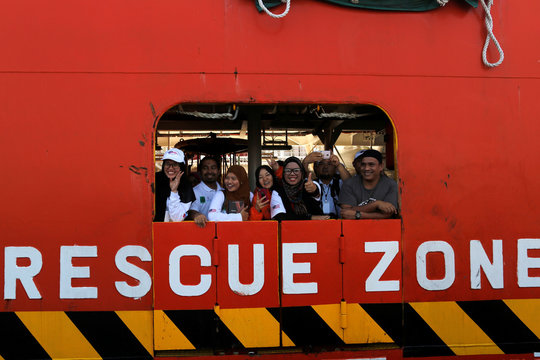 A Malaysian NGO's aid ship carrying food and emergency supplies for Rohingya Muslims arrives at the port in Yangon