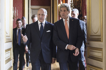 French Foreign Affairs Minister Fabius and US Secretary of State Kerry arrive at the French Foreign Affairs Ministry for a meeting in Paris