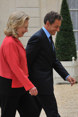 "France's President Sarkozy welcomes U.S. Secretary of State Clinton prior to the opening of the ""Friends of Libya"" conference at the Elysee Palace in Paris"