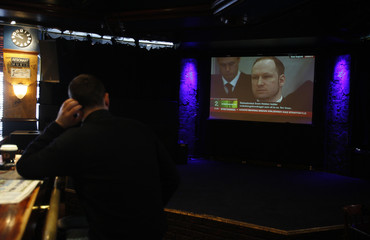 Man watches the live broadcast of the trial of Norwegian mass killer Anders Behring Breivik at a bar in Oslo