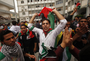 Palestinians celebrate the reconciliation agreement between rival Fatah and Hamas during a rally in Gaza City