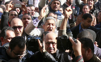 Former U.N. nuclear watchdog head Mohamed ElBaradei arrives at a mosque to pray with some protesters, along a street in Cairo