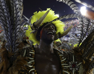 A reveller of the Salgueiro samba school participates in the annual Carnival parade in Rio de Janeiro's Sambadrome