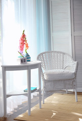 White chair in a room with flowers