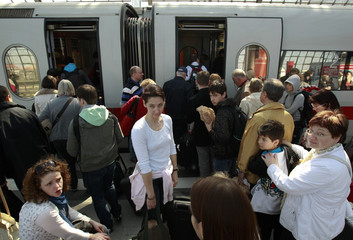 People board a  train at Berlin's main train station