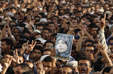 An anti-regime protester holds up a picture of the Nobel Peace Prize laureate Tawakul Karman, during a rally to greet her upon her arrival in Sanaa