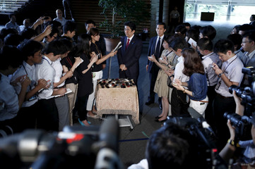 Japan's Prime Minister Abe speaks to reporters after meeting with Mori president of the Tokyo 2020 Organizing Committee of Olympic and Paralympic games, at Abe's official residence in Tokyo