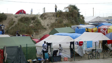 """General view of makeshift shelters in the northern area of the camp called the """"Jungle"""" in Calais, France"""