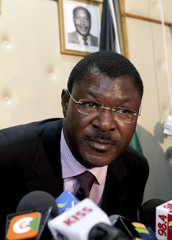 Kenya's Foreign Affairs Minister Wetangula leaves after a news conference in his offices in the capital Nairobi