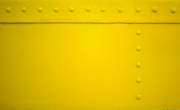 yellow metal plate with rivet for grunge or abstract background.