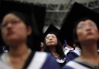 Students attend their graduation ceremony in Shanghai's Fudan University