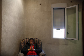 Hernandez, from the Dominican Republic, prays as he waits for his eviction to be carried out in Madrid