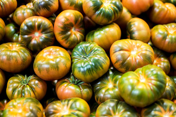 Organic Tomatoes Background. Stack of Organic Tomatoes Close Up.