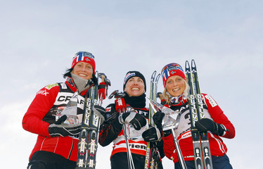 Winner Kowalczyk of Poland celebrates on the podium with second placed Bjoergen of Norway and third placed Johaug of Norway after she won the ladies' FIS Tour de Ski 9km free final climb pursuit start in Val di Fiemme